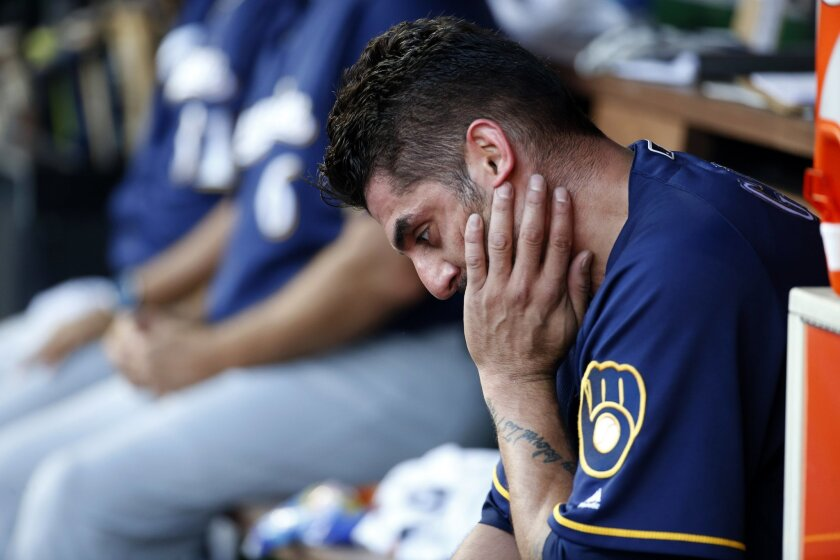 Milwaukee Brewers starting pitcher Matt Garza sits in the dugout after he was relieved during the fifth inning of a baseball game against the Washington Nationals at Nationals Park, Wednesday, July 6, 2016, in Washington. (AP Photo/Alex Brandon)