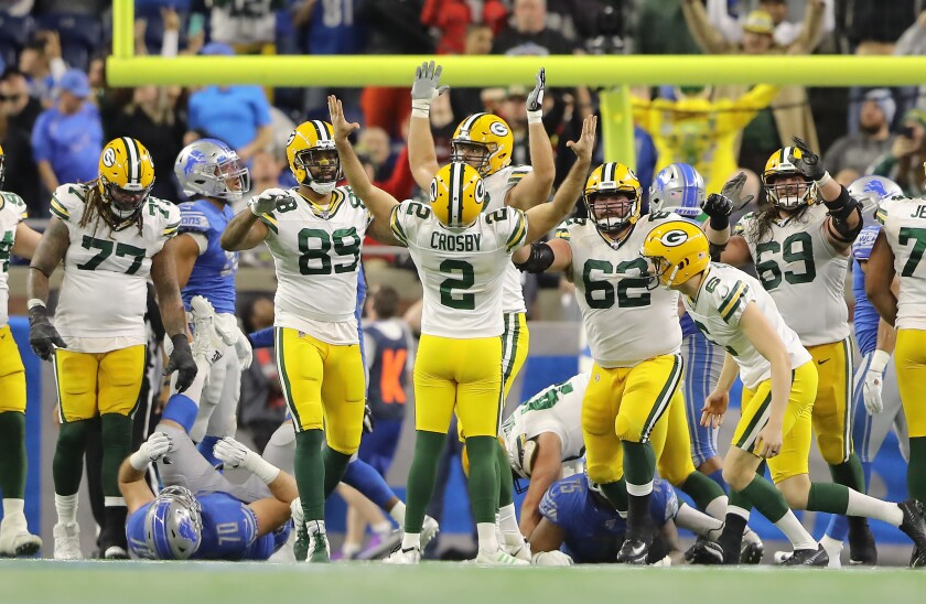 Mason Crosby celebrates after kicking a game-winning field goal in the Green Bay Packers' victory over the Detroit Lions.