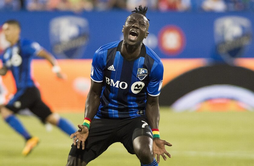 Montreal Impact's Dominic Oduro reacts after missing a shot on goal during first-half MLS soccer game action against the Los Angeles Galaxy in Montreal, Saturday, May 28, 2016. (Graham Hughes/The Canadian Press via AP) MANDATORY CREDIT