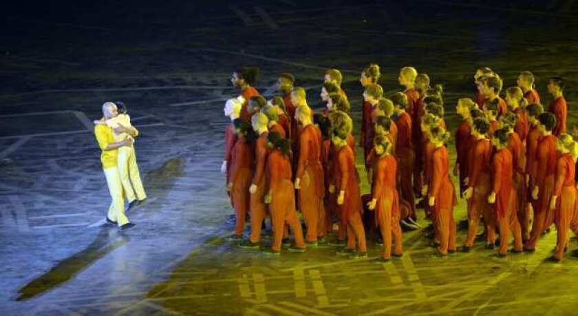 Akram Khan performs with dancers during the opening ceremony of the London 2012 Olympic Games at the Olympic Stadium on Friday.
