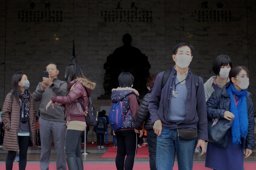 Tourists visit the Chiang Kai-shek Memorial Hall during the fourth day of the Lunar New Year celebration in Taipei, Taiwan, in January.