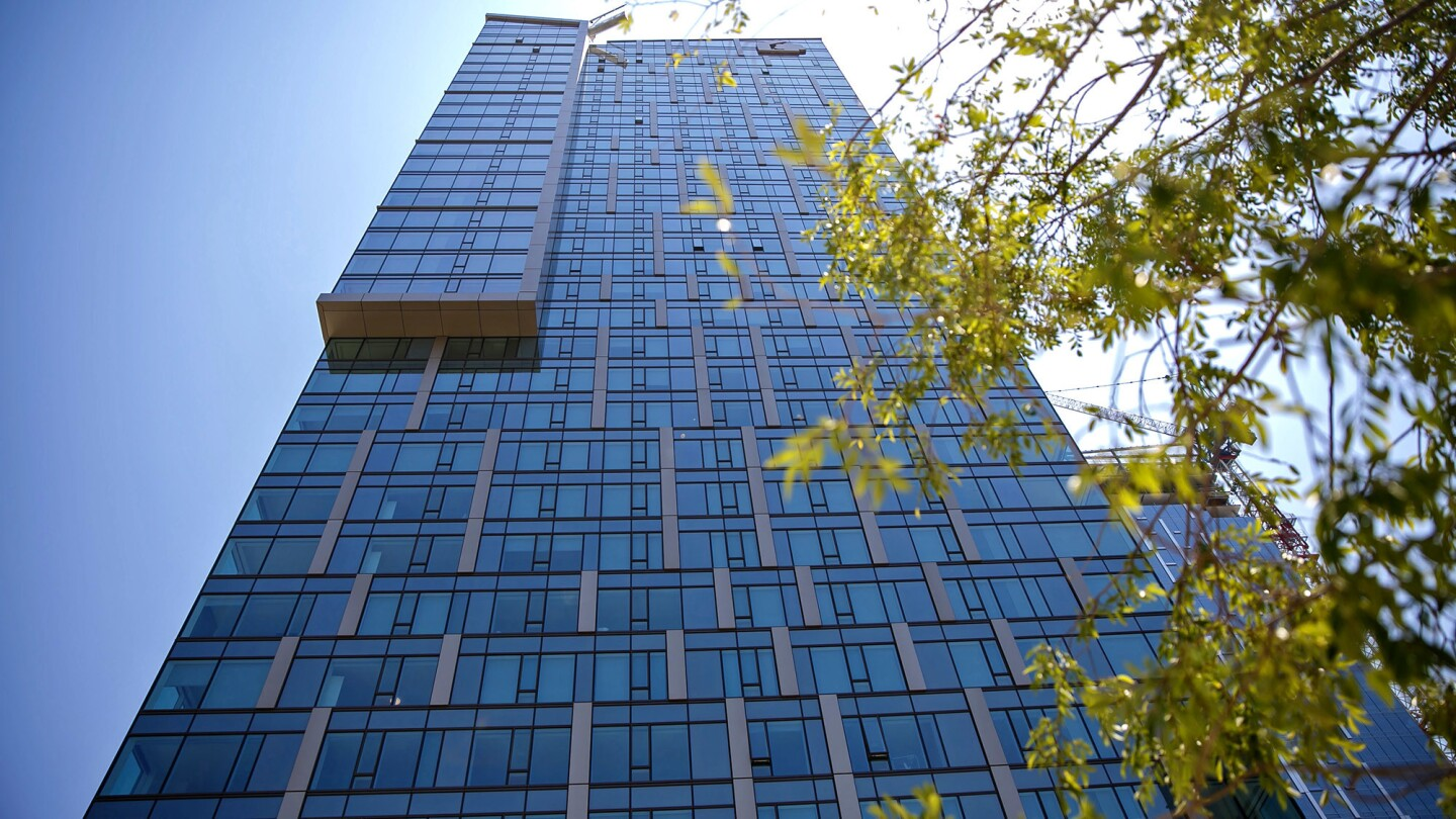 Tower 1 of Metropolis,one of the biggest real estate developments in Los Angeles history, officially opens Thursday amid a wave of construction downtown.