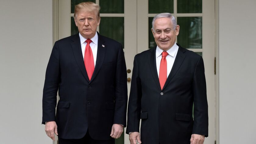 President Trump greets Israeli Prime Minister Benjamin Netanyahu in the Rose Garden of the White House on March 25.