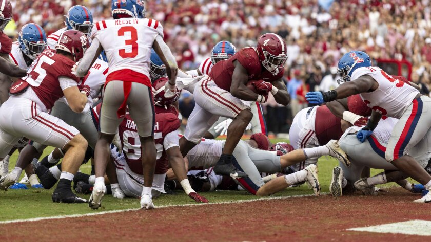 Alabama running back Brian Robinson Jr. (4) runs the ball in for a touchdown against Mississippi during the second half of an NCAA college football game, Saturday, Oct. 2, 2021, in Tuscaloosa, Ala. (AP Photo/Vasha Hunt)
