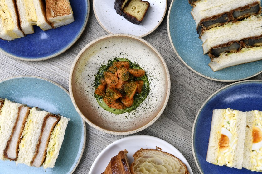 LOS ANGELES, CA-January 18,2019: This colorful spread of dishes at Konbi include, (from top clockwise to center), the Canel?, Eggplant Katsu, Egg Salad, Butter Croissant, Pork Katsu, Layered Omelette and Carrots Crudit?. (Mariah Tauger / Los Angeles Times)