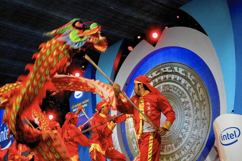 Intel is adding more complex products made at its semiconductor factory in Ho Chi Minh City, Vietnam. Above, a dragon dance is performed at the opening ceremony of the facility in 2010.