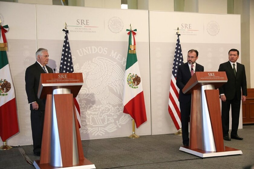 U.S. Secretary of State Rex Tillerson, left, and Mexican Foreign Minister Luis Videgaray give remarks after their meeting in Mexico City on Thursday. Mexican Interior Secretary Miguel Angel Osorio Chong is at far right.