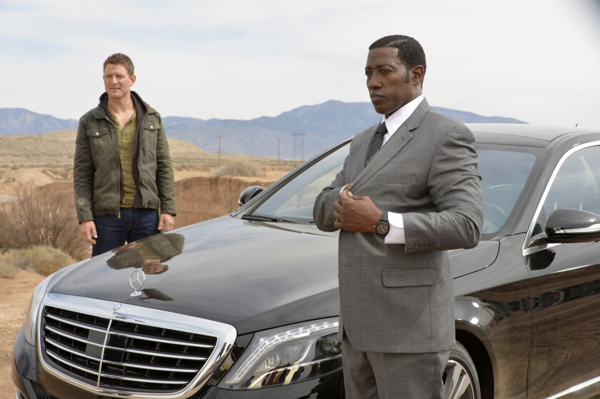 "Philip Winchester, left, and Wesley Snipes in ""The Player."""