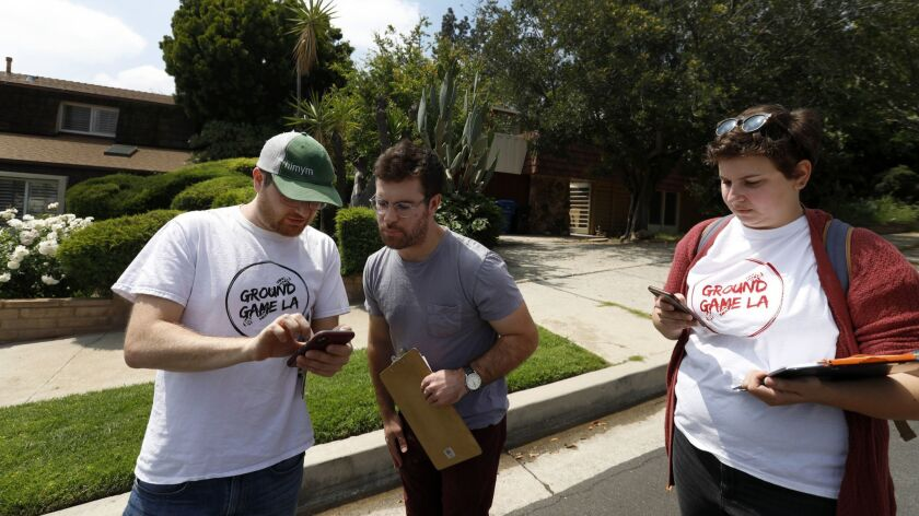 Jesse Alson-Milkman, 37, from left, Ian Carr, 28, and Brooke Jacobovitz, 25, canvass for L.A. City Council candidate Loraine Lundquist in Granada Hills on May 11.