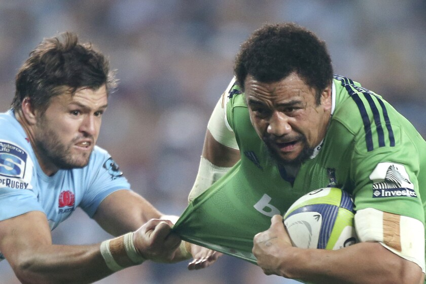 FILE - In this June 27, 2015, file photo, Waratahs' Adam Ashley-Cooper, left, tugs on the shirt of Highlanders' Nasi Manu during their Super Rugby semifinal match in Sydney. The 31-year-old Manu is on the brink of playing his first game at the World Cup, and first since being diagnosed with testicular cancer. He missed all of 2018 and feared for his life, not just his career, while having to undergo emergency surgery and months of chemotherapy. (AP Photo/Rick Rycroft, File)