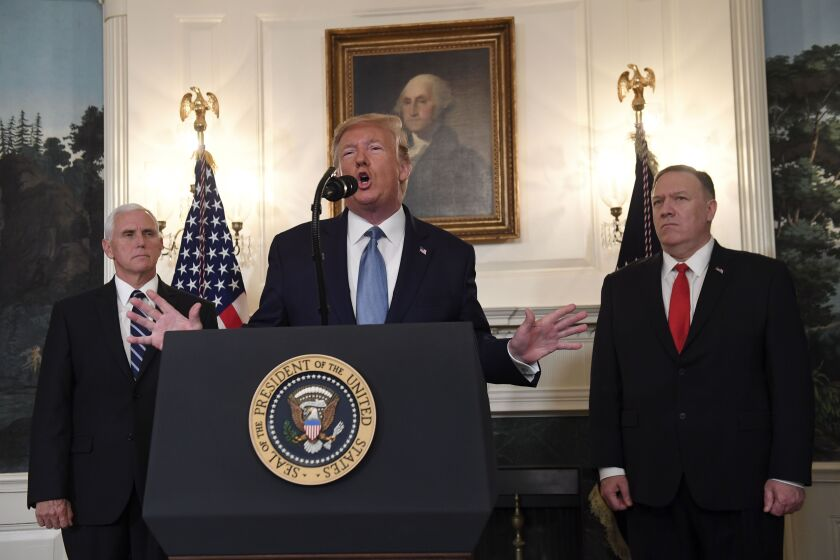 President Trump speaks about Syria next to Vice President Mike Pence and Secretary of State Mike Pompeo.