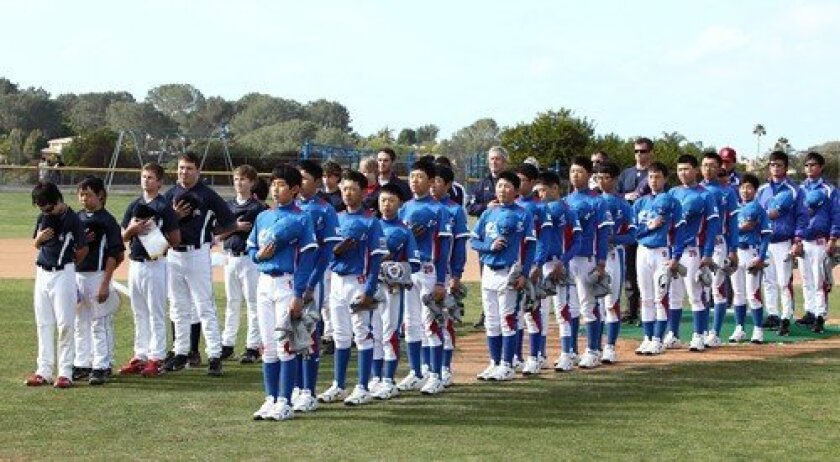 Players from the Del Mar Powerhouse and Korea teams listen as the national anthems of both countries are performed. Photo: Jon Clark