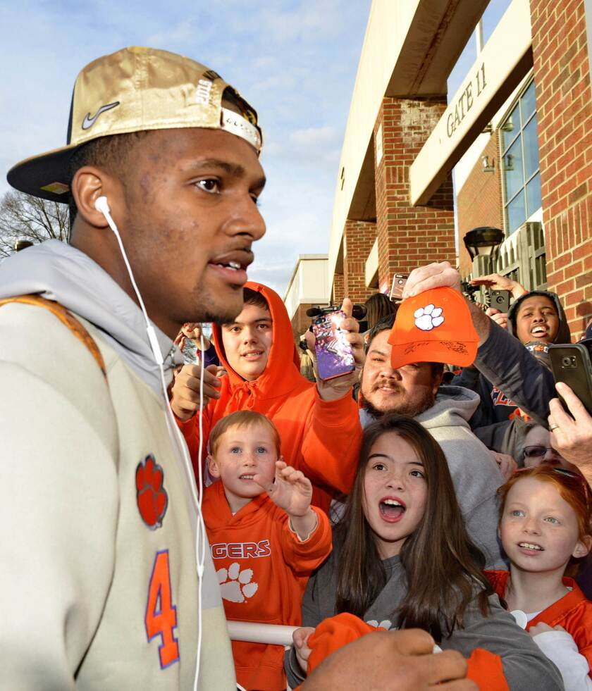 Young fans react as Clemson's Deshaun Watson returns, Tuesday, Jan. 10, 2017, in Clemson, S.C., the day after the Tigers defeated Alabama 35-31 in the College Football Playoff championship NCAA college football game in Tampa.