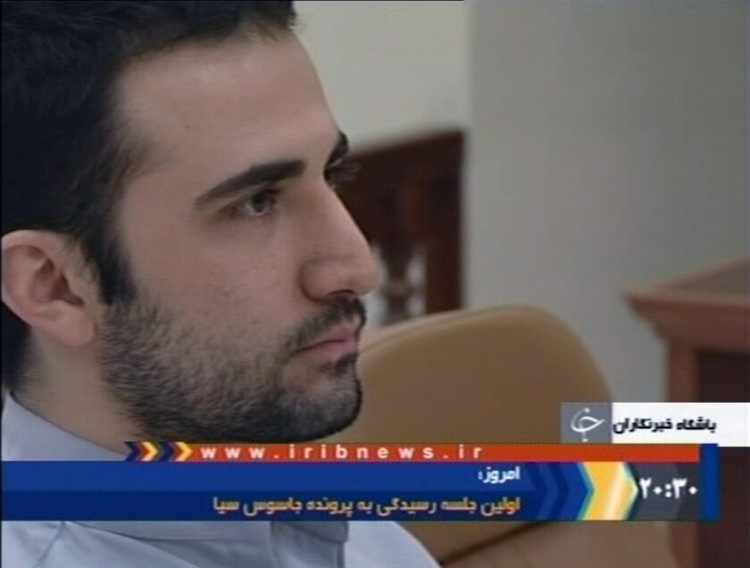 In this video frame grab image made from the Iranian broadcaster IRIB TV, U.S. citizen Amir Hekmati sits in Tehran's revolutionary court in Iran on Dec. 27, 2011.