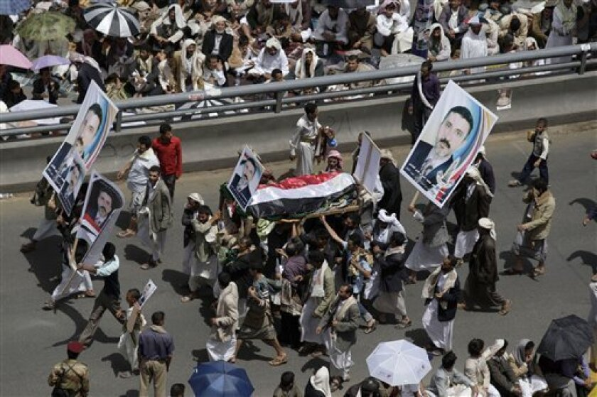 Relatives of a tribesman, loyal to Sheik Sadeq al-Ahmar, the head of the powerful Hashid tribe, who was killed recently in clashes with Yemeni security forces, carry his body during his funeral procession in Sanaa, Yemen, Friday, June 10, 2011. Nearly 100,000 Yemenis are protesting in a main square of the capital demanding the wounded president, currently outside the country, be removed from power. (AP Photo/Hani Mohammed)