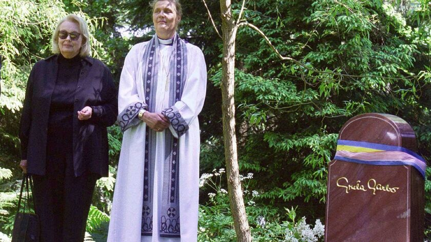 FILE - In this June 17, 1999 file photo, Gray Gustafson Reisfield, left, and Bishop Caroline Krook s