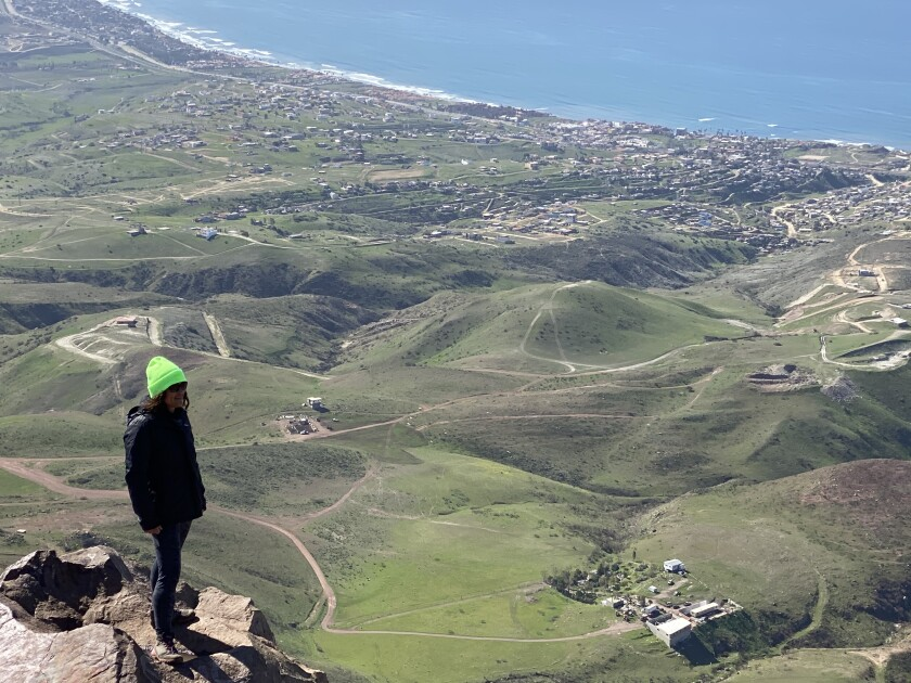 Teacher Karla Vasquez looks out at the panoramic views over Baja California from Cerro Coronel.