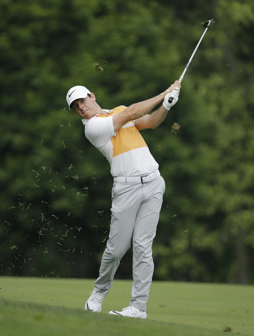 Rory McIlroy, of Northern Ireland, hits from the 13th fairway during the first round of the Memorial golf tournament, Thursday, June 2, 2016, in Dublin, Ohio. (AP Photo/Darron Cummings)