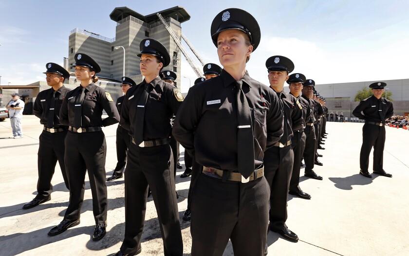 People in uniforms standing.
