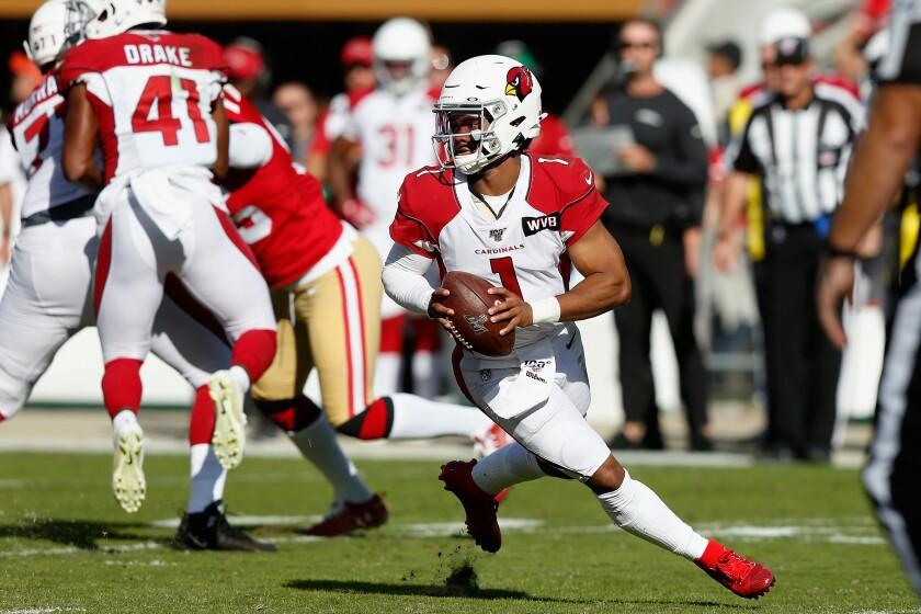 Arizona Cardinals quarterback Kyler Murray looks to pass.