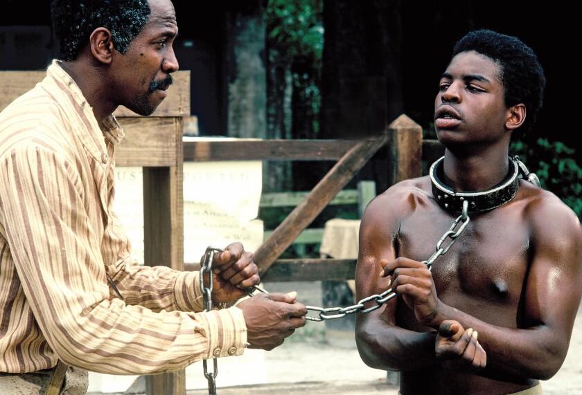 "Louis Gossett Jr., left, and LeVar Burton starred in the original ""Roots"" miniseries."