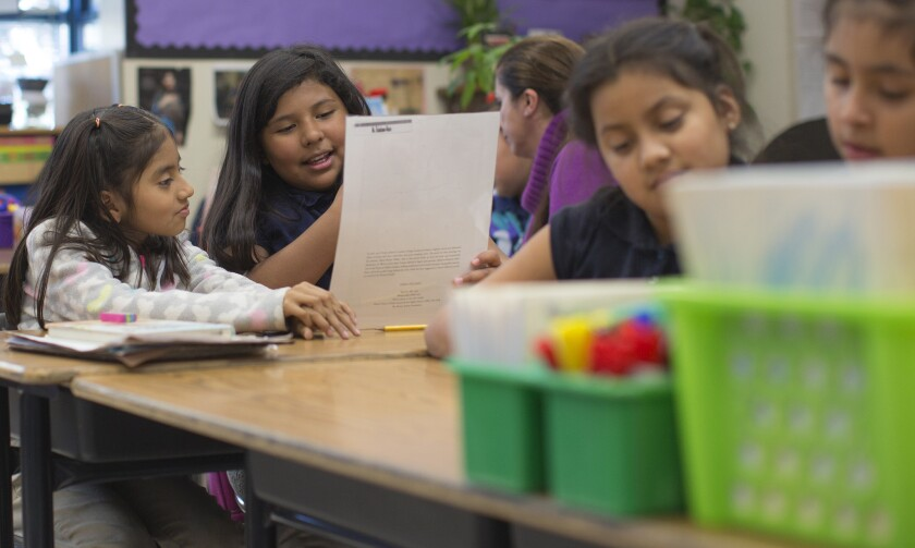 A bill in Sacramento to repeal the cap on how much money school distrcits can keep in reserve faces party-line opposition. Above, third grade students at Gratts Elementary School in Los Angeles.