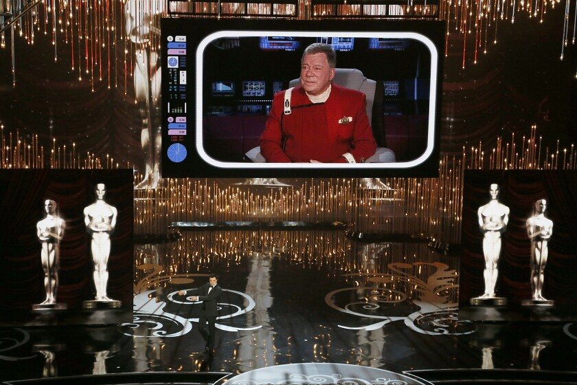 """Seth MacFarlane's opener proved to be one of the most bewildering Oscar openers in recent memory. With a cameo appearance by William Shatner squeezed into his old """"Star Trek"""" uniform, a tribute to film nudity called """"We Saw Your Boobs"""" with the Los Angeles Gay Men's Chorus and finally a song and dance with Channing Tatum, Charlize Theron, Joseph Gordon-Levitt and Daniel Radcliffe, some people were probably numb by the time they got to the sock-puppet re-creation of """"Flight"""" or MacFarlane's monologue jokes that seemed cribbed from Bob Hope circa 1965."""