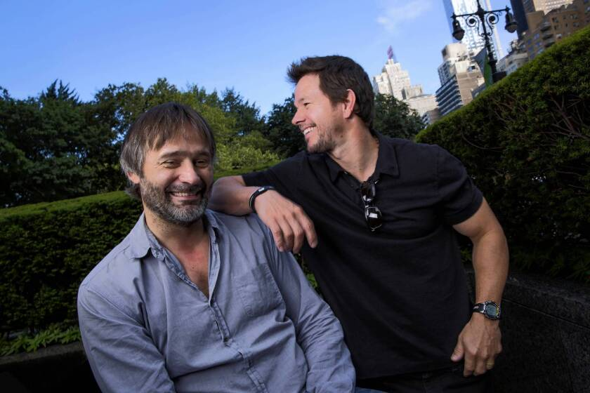 """Director Baltasar Kormakur, left, is working with Mark Wahlberg, right, on their second movie together """"2 Guns."""""""