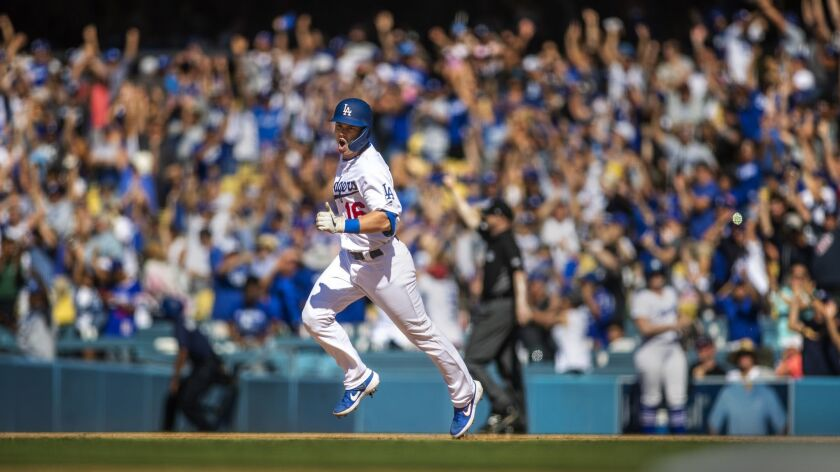 LOS ANGELES, CALIF. -- SUNDAY, JUNE 23, 2019: As the crowd cheers, Dodgers rookie Will Smith celebra