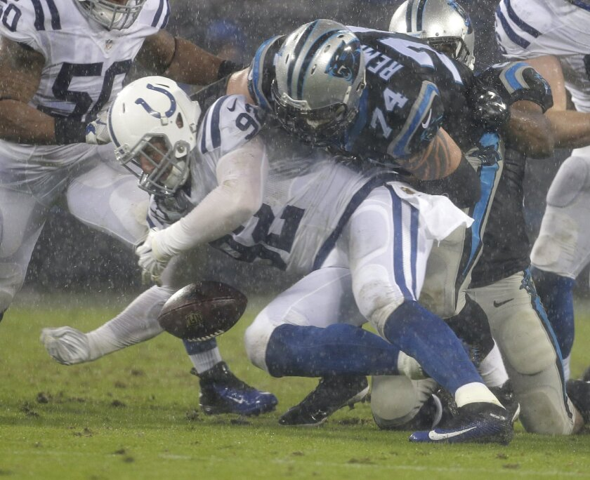 Indianapolis Colts' Bjoern Werner (92) recovers a fumble by the Carolina Panthers as Carolina Panthers' Mike Remmers (74) closes in during the first half of an NFL football game in Charlotte, N.C., Monday, Nov. 2, 2015. (AP Photo/Bob Leverone)