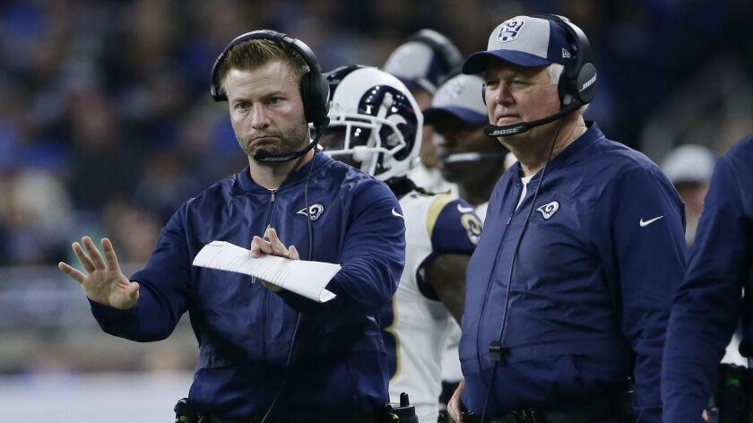 Los Angeles Rams head coach Sean McVay motions to his team with defensive coordinator Wade Phillips,