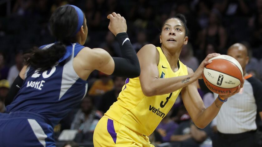 The Sparks' Candace Parker shoots against the Lynx's Maya Moore during a game in August.