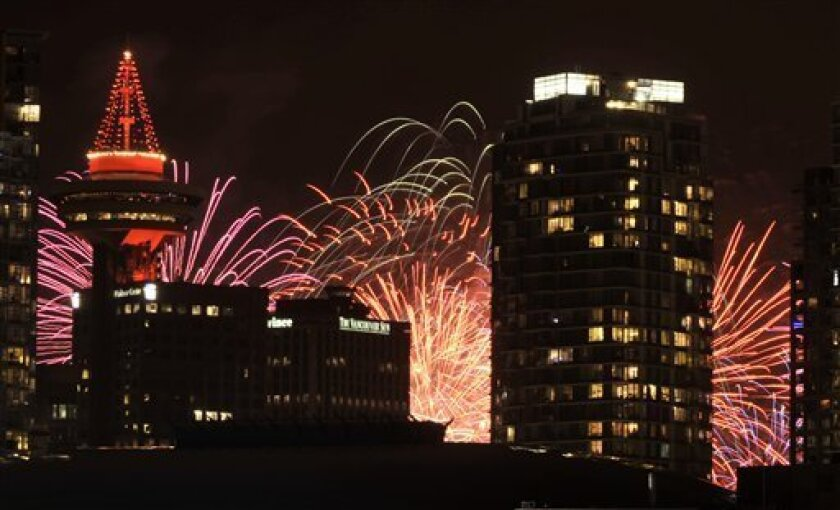 Fireworks are seen after the opening ceremony for the Vancouver 2010 Olympics in Vancouver, British Columbia, Friday, Feb. 12, 2010. (AP Photo/Bela Szandelszky)