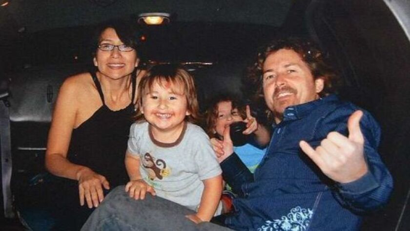 Joseph and Summer McStay with their children, Joseph Jr.. 3, front, and Gianni, 4.