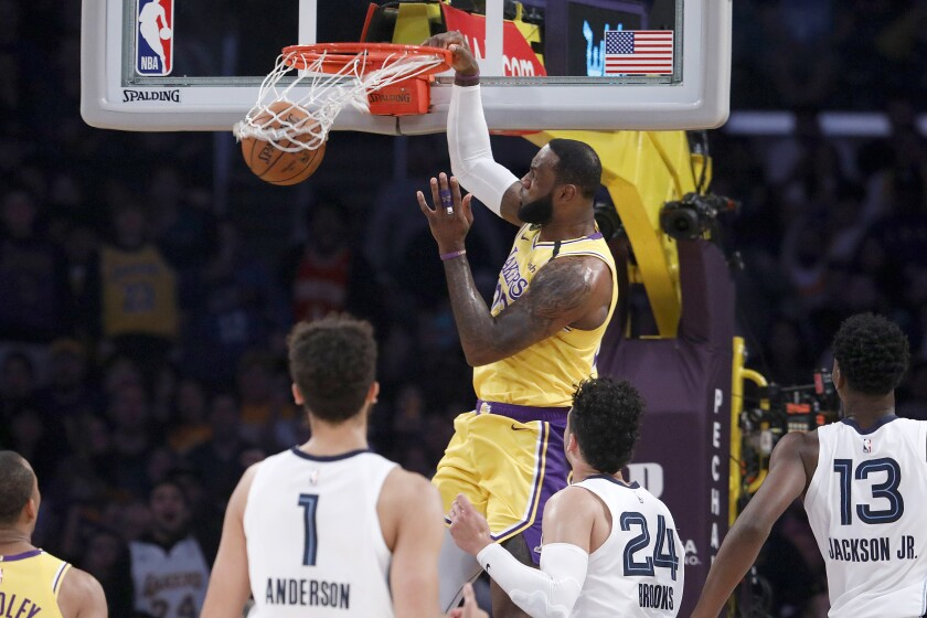 Lakers forward LeBron James throws down a dunk against the Grizzlies during a game Feb. 21, 2020, at Staples Center.