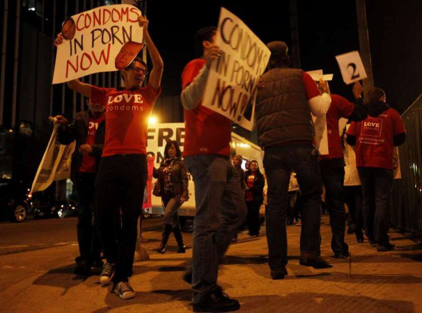 AIDS Healthcare Foundation protesters are seen in 2011 outside the XBiz Awards at the Palladium in Los Angeles.