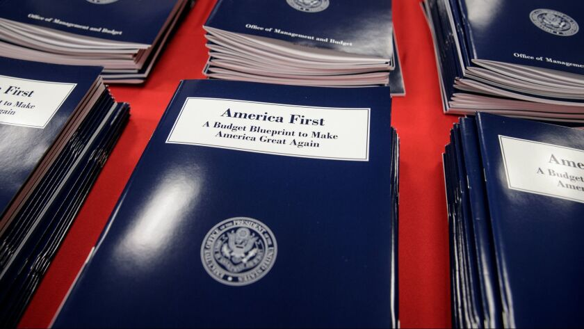 Copies of President Trump's first budget are displayed at the Government Printing Office on March 16 in Washington.