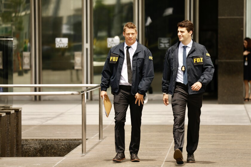 FBI agents leave the downtown headquarters of the Los Angeles Department of Water and Power.