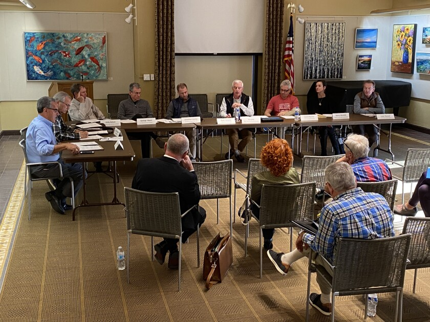 Enhance La Jolla members Joe LaCava, John Unbewust, Andy Nelson, George Hauer, Jonathan Lipsky, Ed Witt, David Marino, Nancy Warwick and Leon Kassel debate an issue at the board's Feb. 13 meeting in the library.
