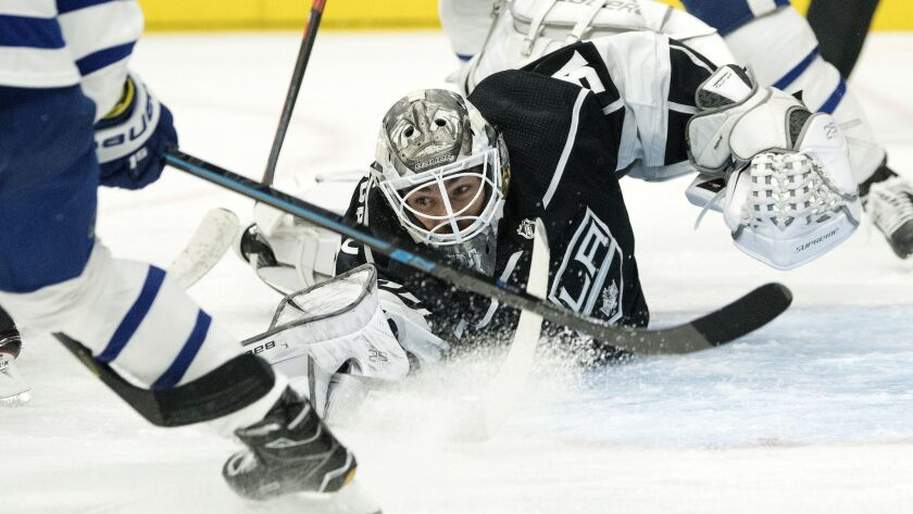 Kings goaltender Peter Budaj reaches to stop a shot during the first period against the Toronto Maple Leafs at Staples Center on Nov. 13.