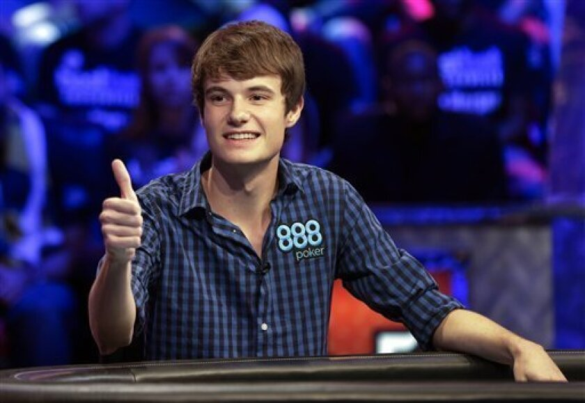 Jake Balsiger reacts to supporters after betting all in and winning the pot on a hand during the World Series of Poker Final Table event, Tuesday, Oct. 30, 2012, in Las Vegas. (AP Photo/Julie Jacobson)