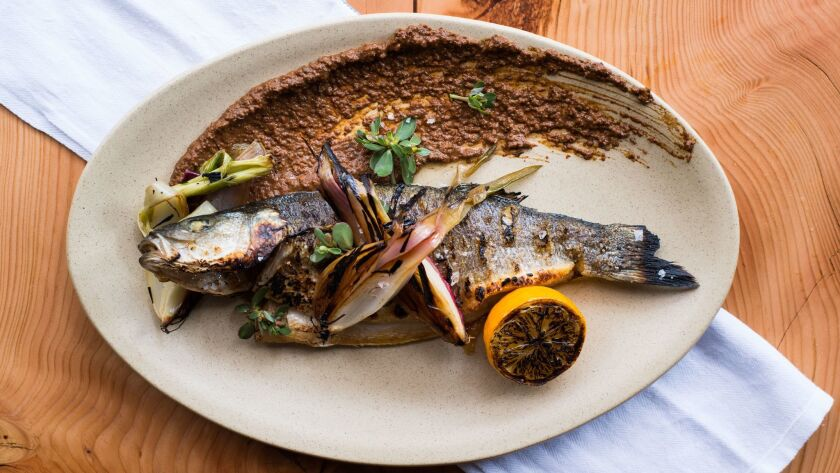 Whole fish is a house specialty on chef Andrew Bachelier's menu at Campfire in Carlsbad.