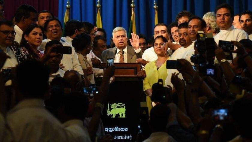 Sri Lankan Prime Minister Ranil Wickremesinghe speaks to supporters at his official residence in Colombo on Sunday after taking the oath of office.