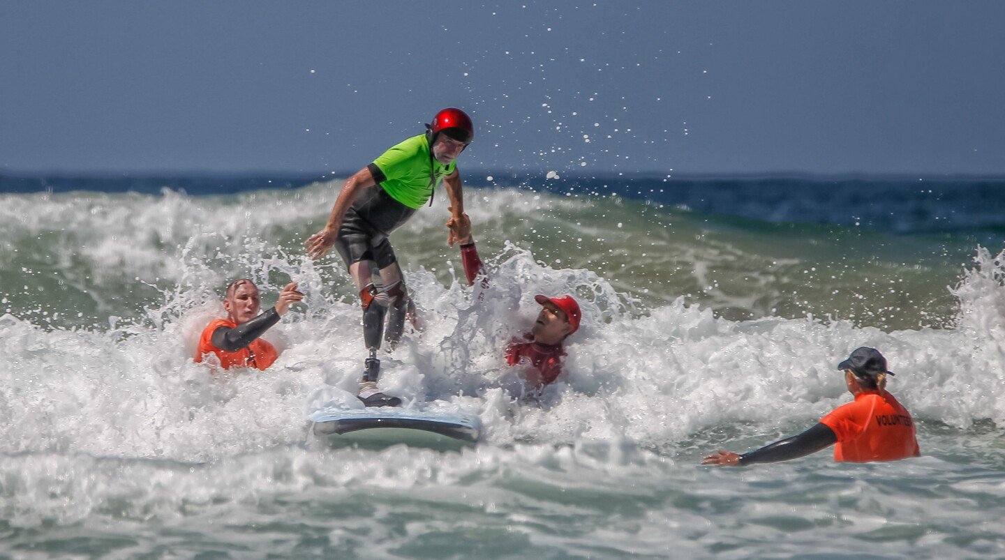 Veteran Dave Nichols launches into a wave during the National Veterans Sports Clinic on Wednesday at la Jolla Shores in San Diego, California.