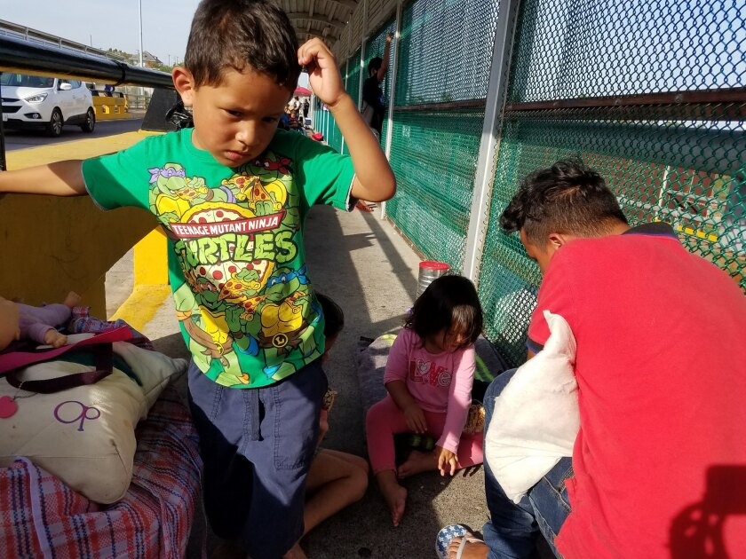 Central American families are camped out on a border bridge between Ciudad Miguel Aleman and Roma, T