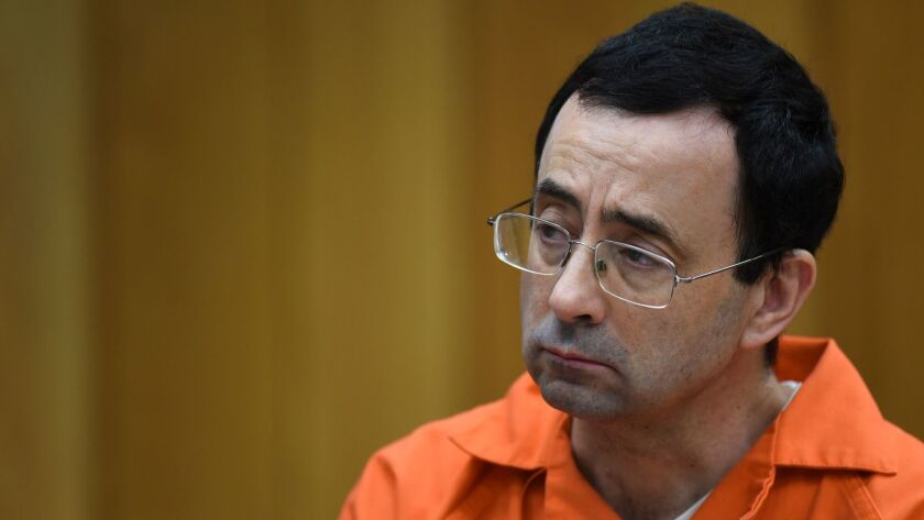 Larry Nassar listens during a hearing in a Charlotte, Mich., courtroom on Feb. 2.