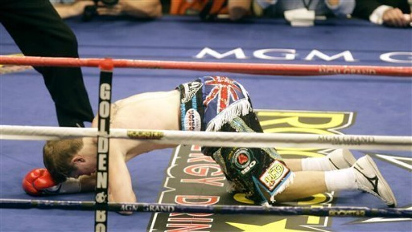 British boxer Ricky Hatton hits the mat after he was knocked down by Manny Pacquiao, of the Philippines, during the first round of their junior welterweight boxing match Saturday, May 2, 2009, in Las Vegas. Pacquiao won the fight by TKO in the second round. (AP Photo/Rick Bowmer)
