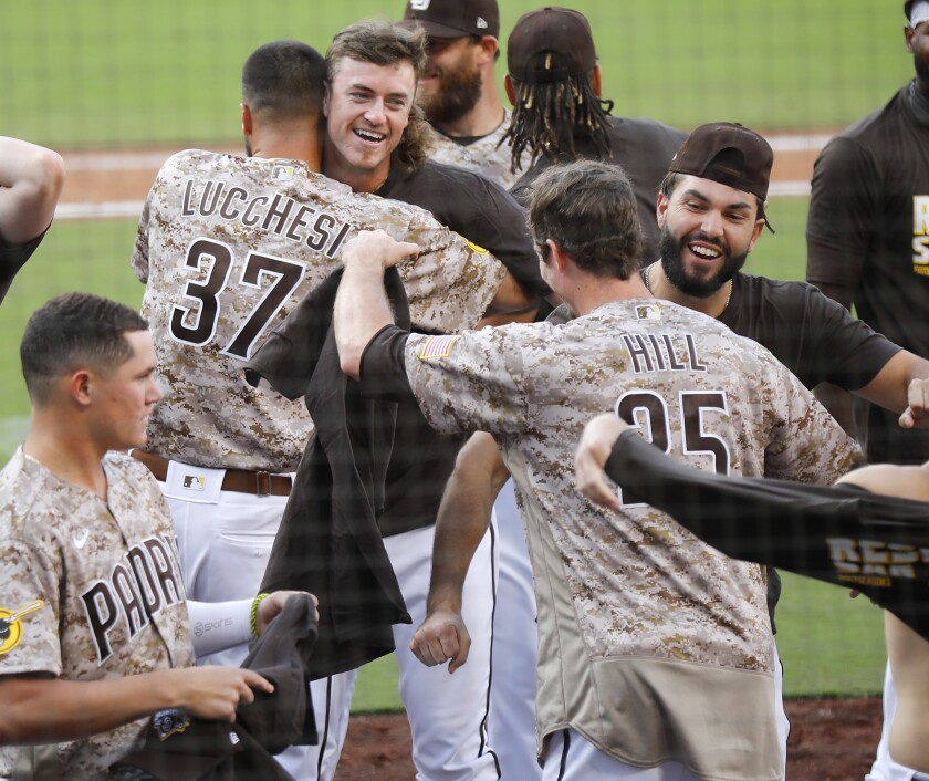 Padres players celebrate after Sunday's win qualified them for the postseason.