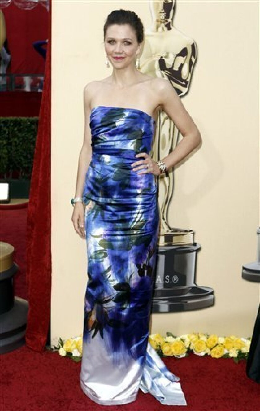 Maggie Gyllenhaal arrives during the 82nd Academy Awards Sunday, March 7, 2010, in the Hollywood section of Los Angeles. (AP Photo/Matt Sayles)