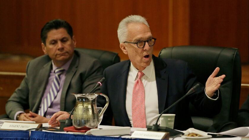 Norman J. Pattiz, right, shown at a UC Board of Regents meeting in March, apologized for his comments about a female podcaster's breasts. At left is Regent Eloy Ortiz Oakley.